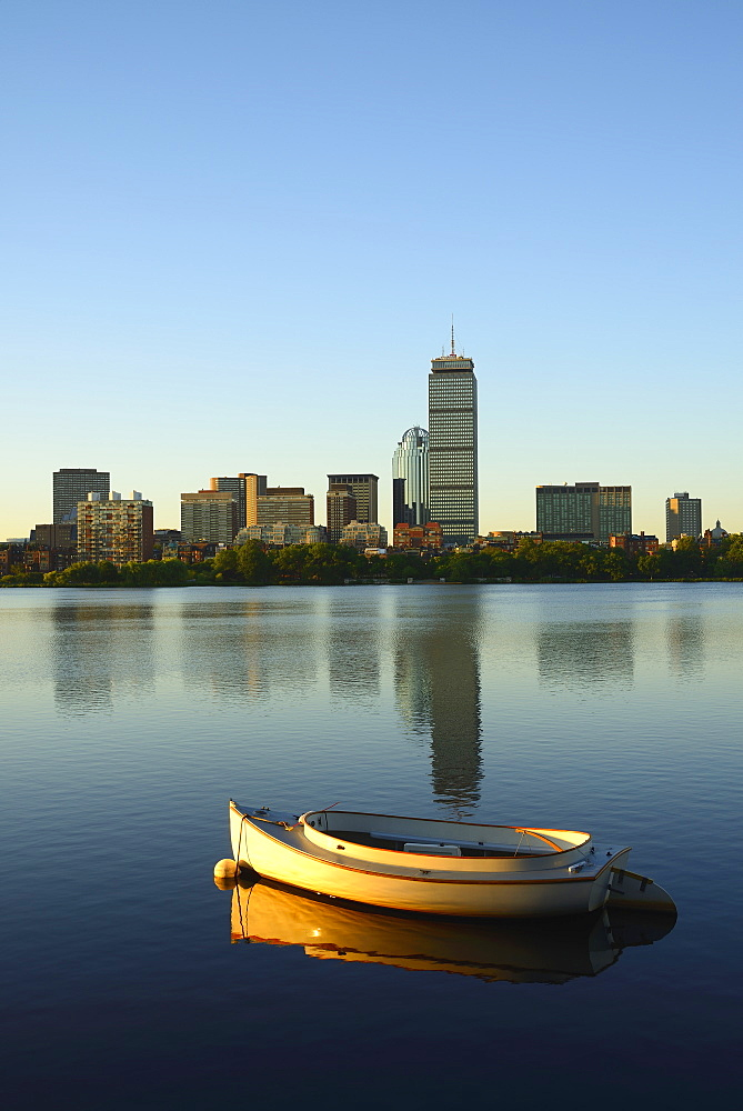 Boat on river with skyline in background, Charles River, Boston, Massachusetts