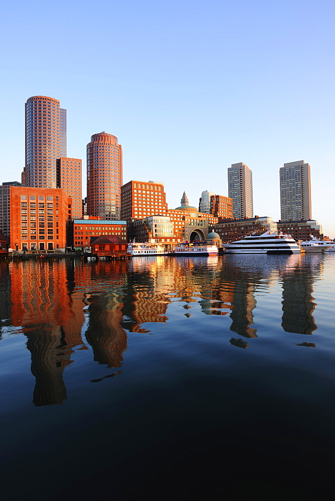 Symmetrical view of architecture reflecting in water, Boston Waterfront, Boston, Massachusetts