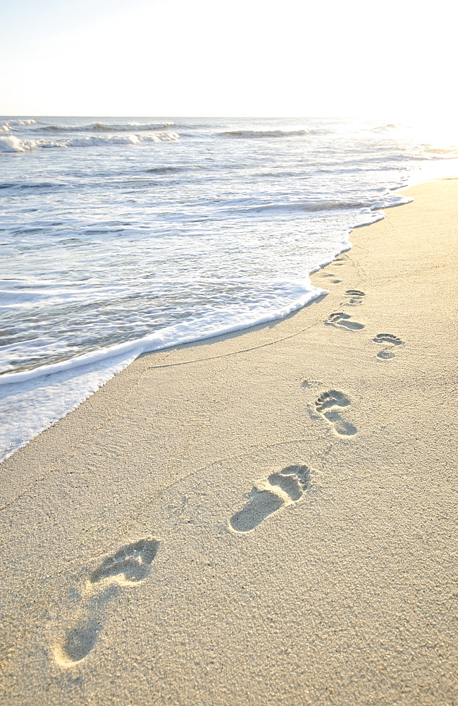 Footprints on beach by sea, Nantucket, Massachusetts,USA