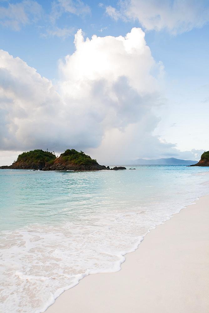 Scenic view of beach by sea, Trunk Bay, St. John, US Virgin Islands