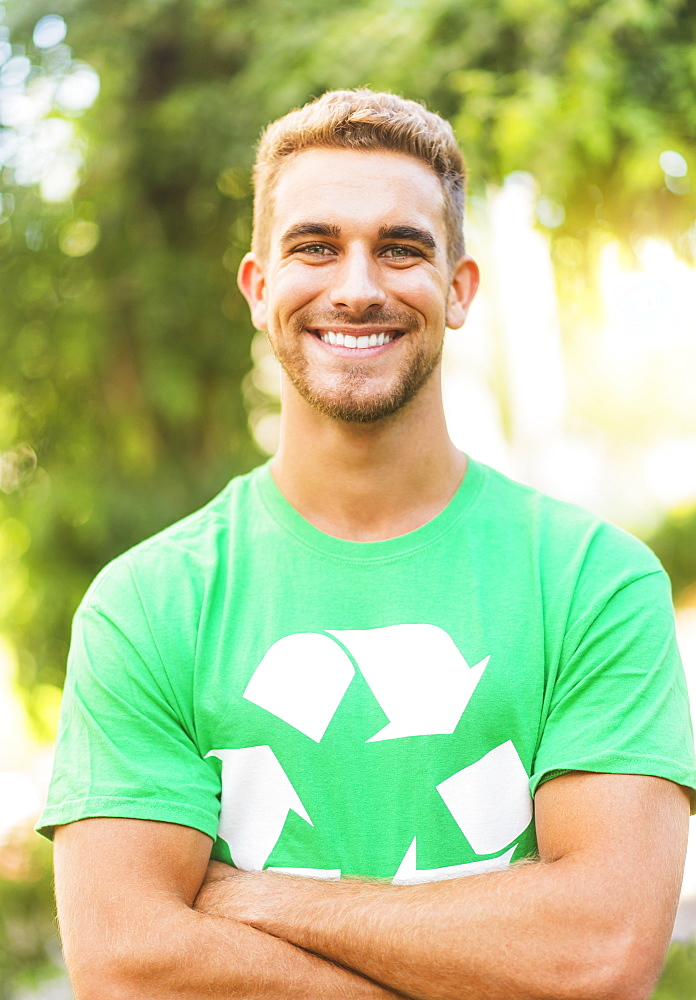 Portrait of young man wearing t-shirt with recycling symbol