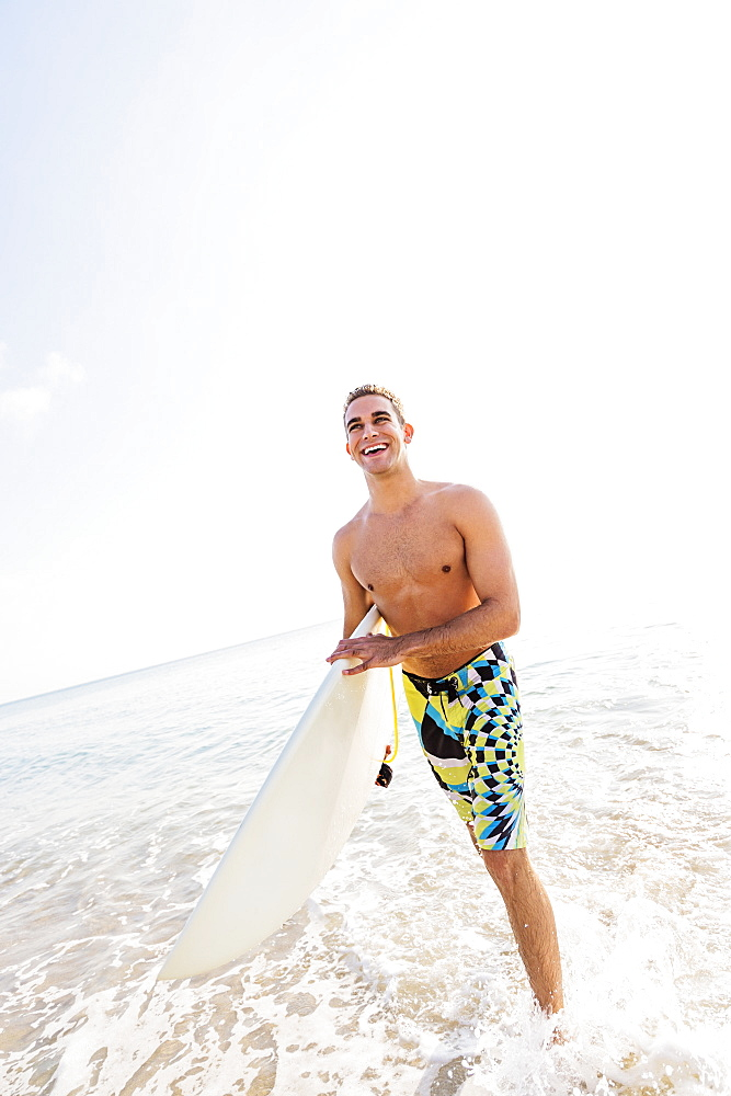 Young surfer laughing, West Palm Beach, Florida,USA
