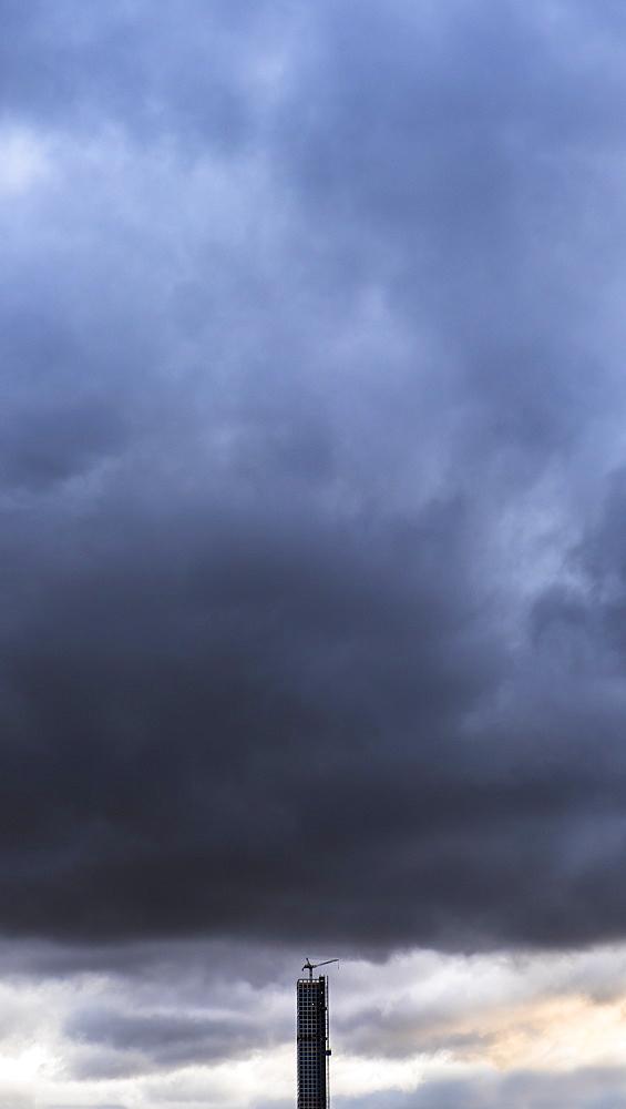 Dramatic sky over skyscraper