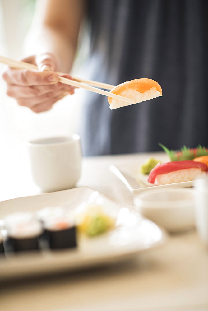 Close-up of woman preparing sushi