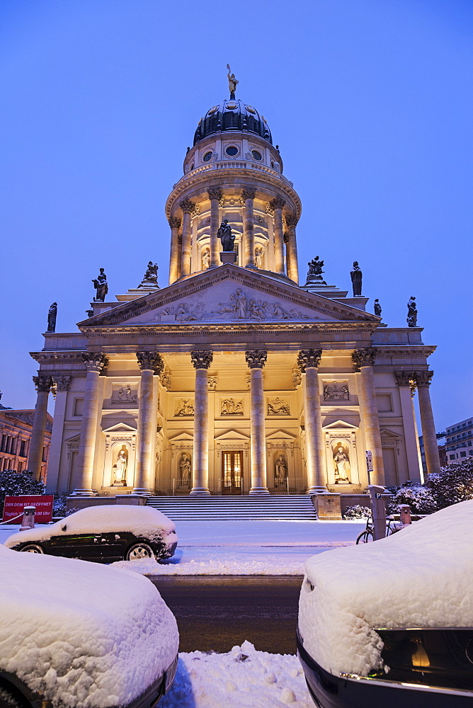 Illuminated French Cathedral in winter, Germany, Berlin, Gendarmenmarkt, French and German Domes