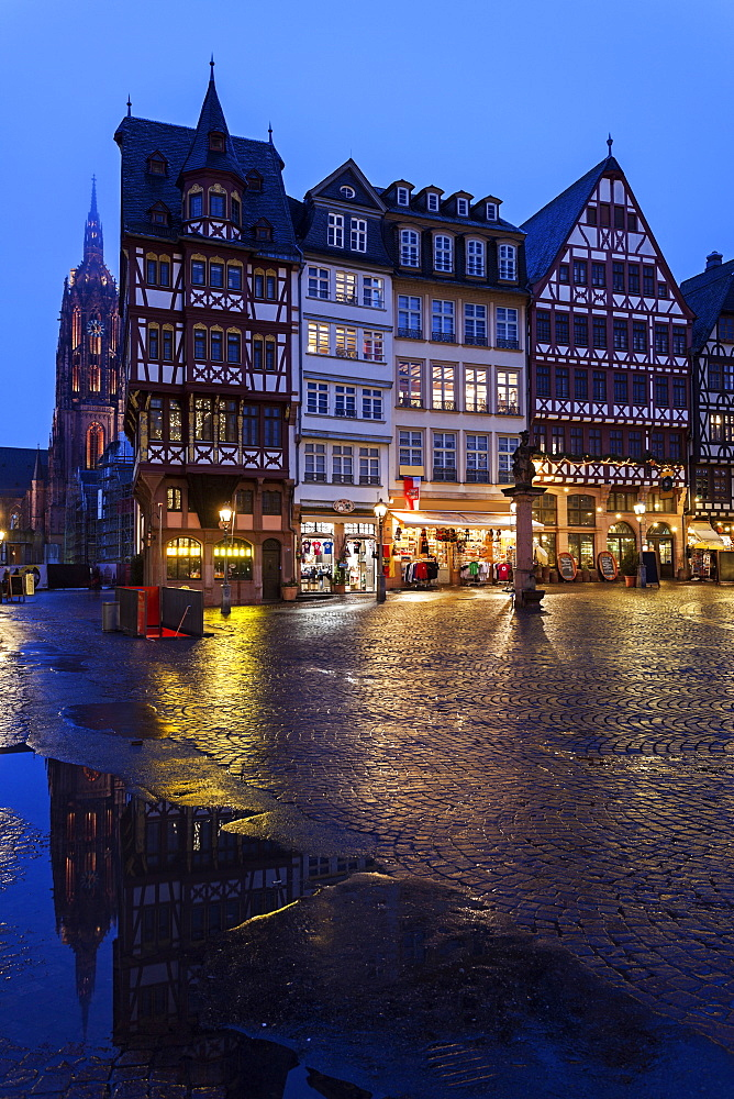 Illuminated townhouses and square, Germany, Hesse, Frankfurt, Romerberg Plaza,Frankfurt Cathedral