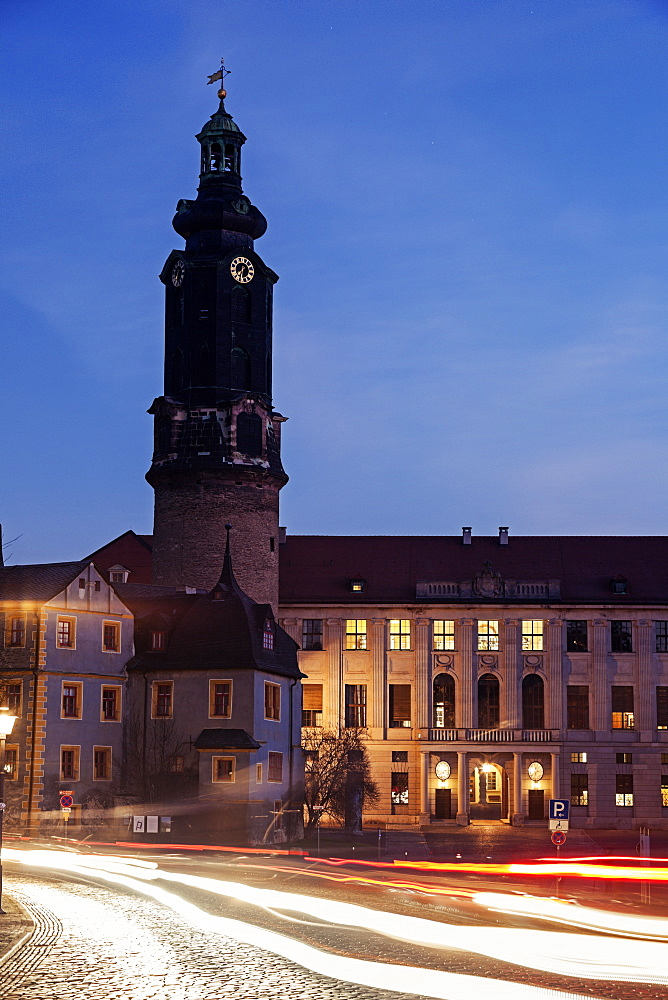 Light trails and clock tower at night, Germany, Thuringia, Weimar