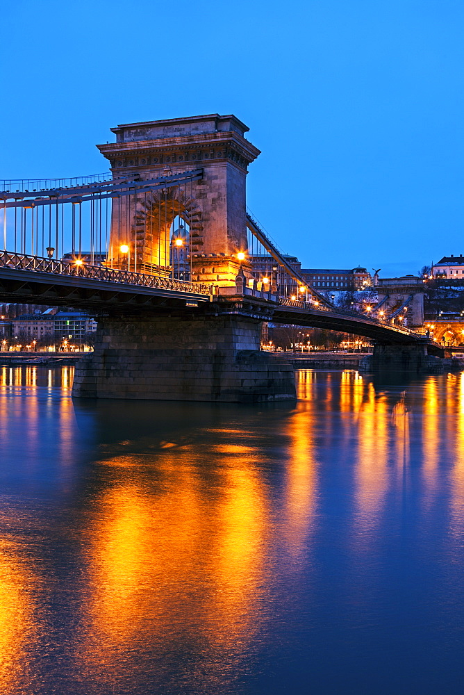 Illuminated Chain Bridge and reflections on water, Hungary, Budapest, Chain bridge
