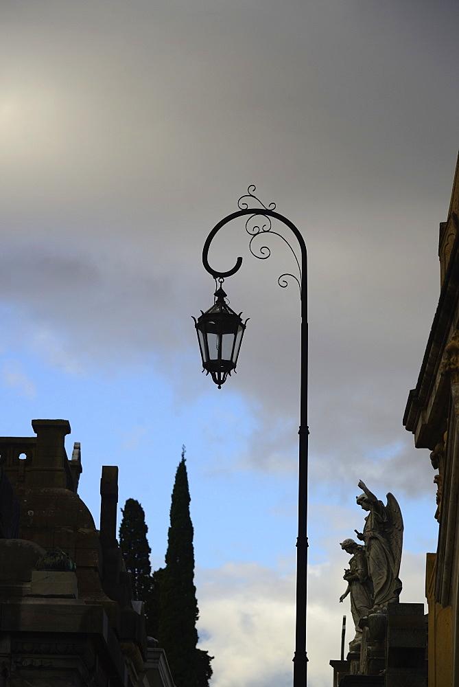 Argentina, Buenos Aires, Recoleta Cemetery, Sculpture and antique street light, Argentina, Buenos Aires, Recoleta Cemetery