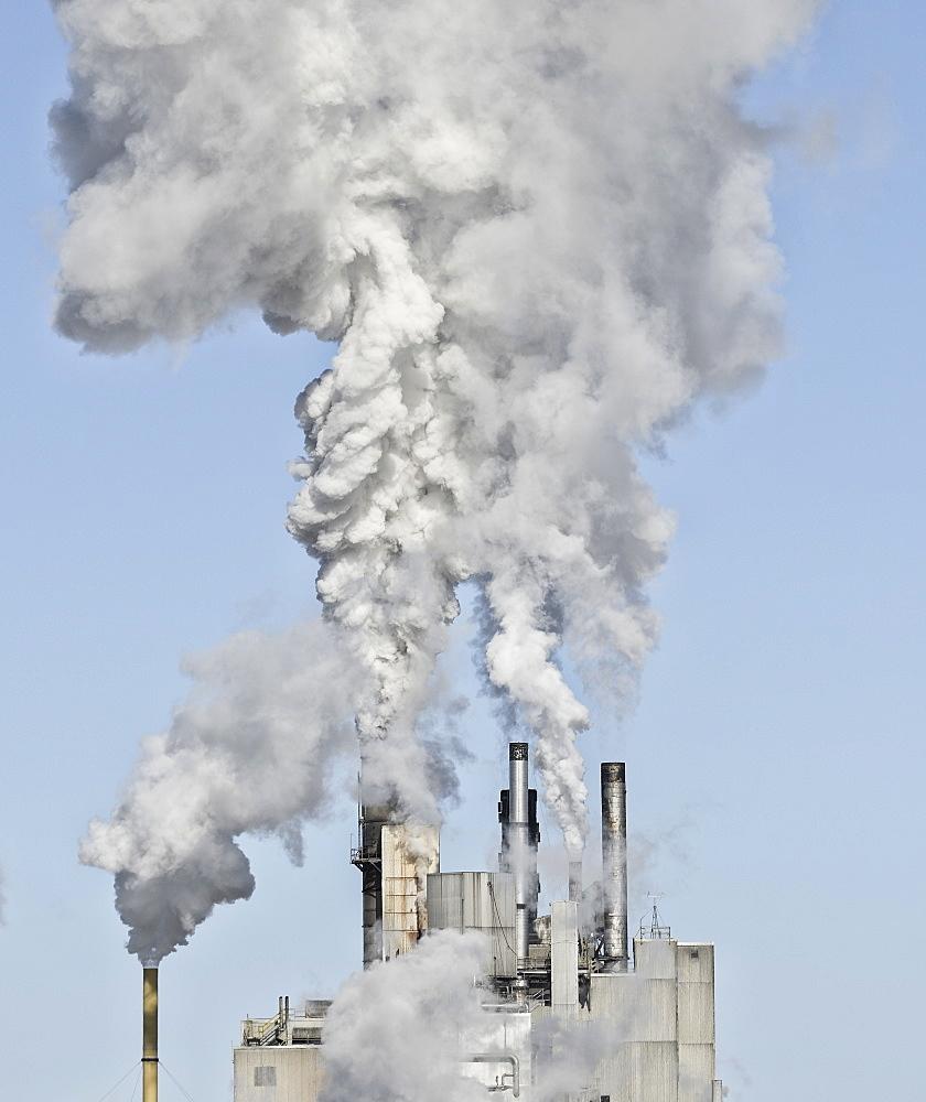 Smoke stacks emitting smoke, USA, New York State, Ticonderoga