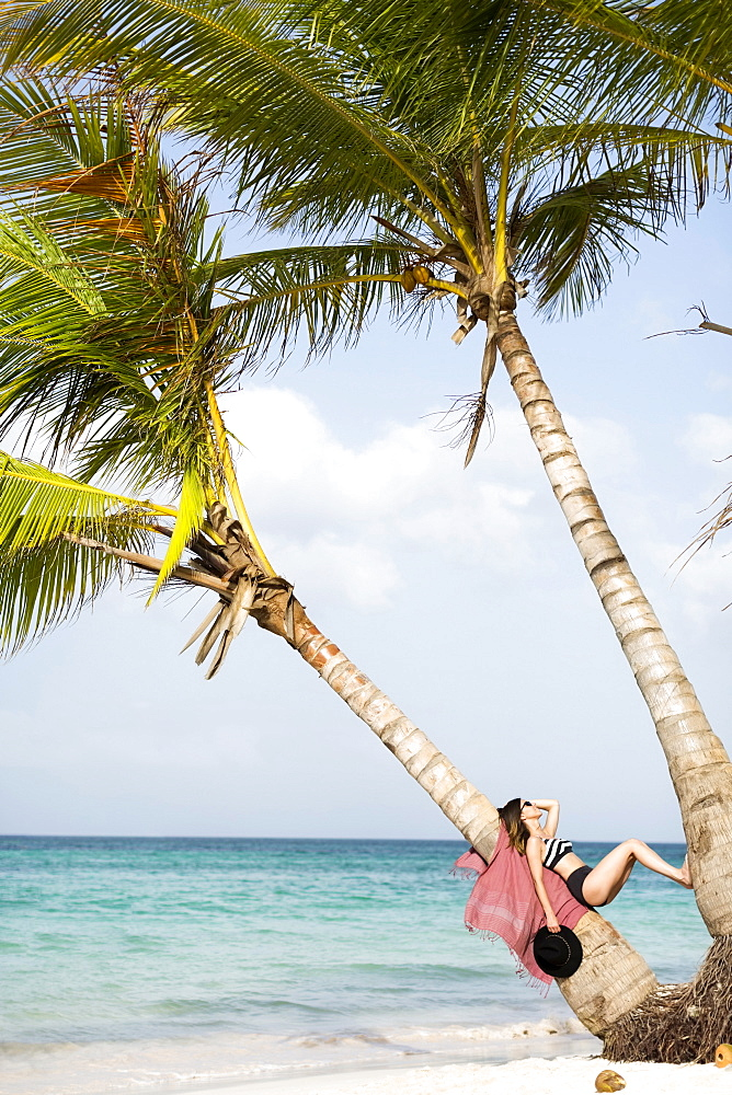 Woman relaxing on beach, Dominican Republic