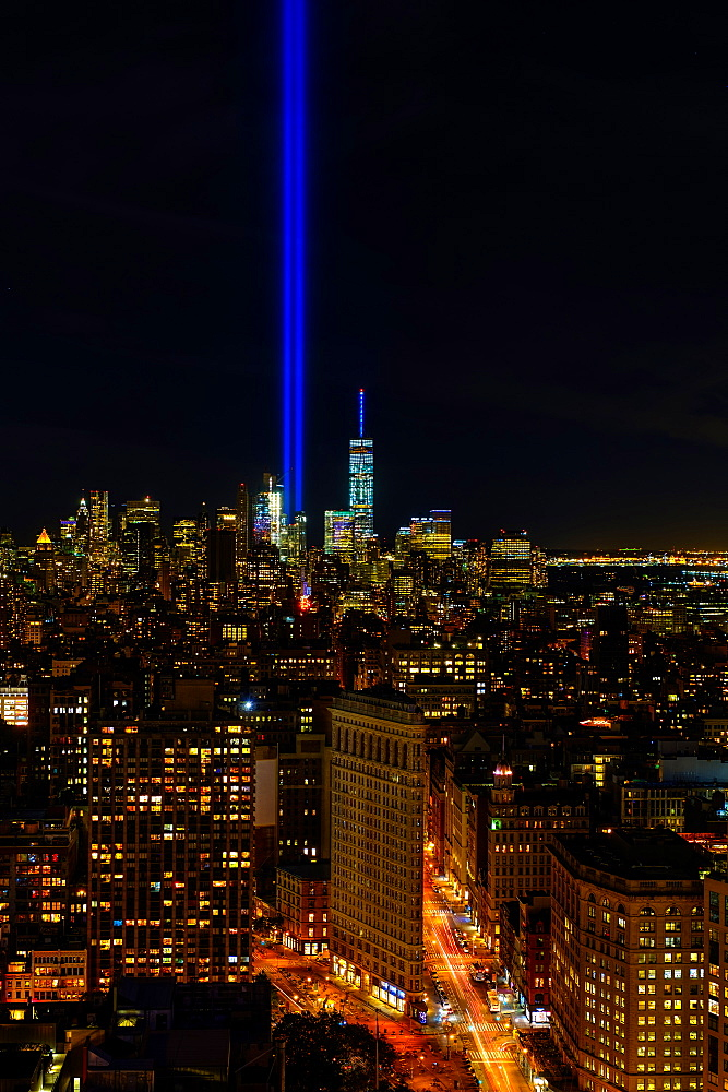 USA, New York State, New York City, Cityscape with light beam over ground zero