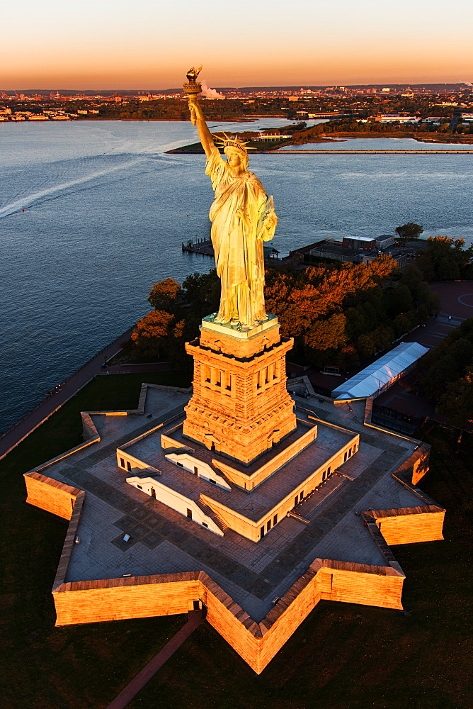 USA, New York State, New York City, Aerial view of Statue of Liberty at sunrise