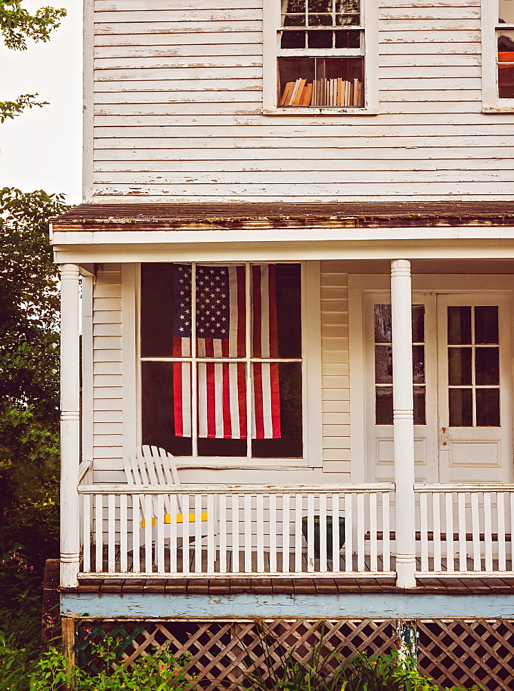 USA, Maine, Knox, American flag hanging in house