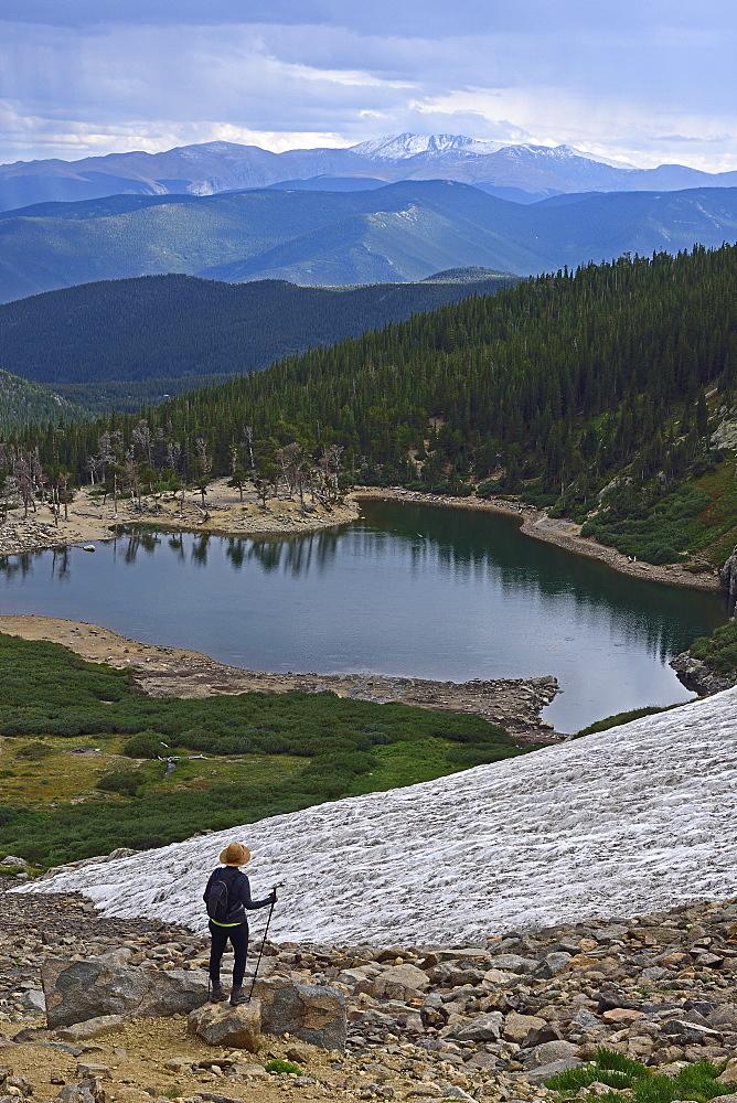USA, Colorado, Idaho Springs, Hiker looking at view from Saint Mary's Glacier