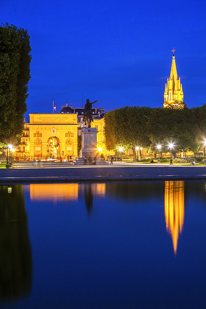France, Occitanie, Montpellier, Porte du Peyrou and St. Anne Church at dusk