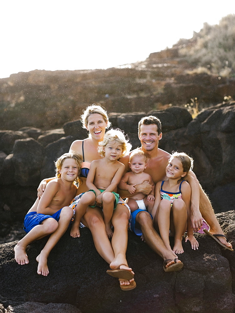 Parents with four children (12-17 months, 4-5, 6-7, 8-9) at beach