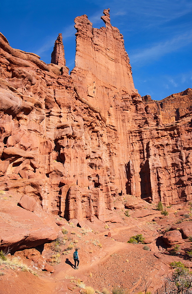 Woman hiking by Fishers Tower in Moab, Utah, USA