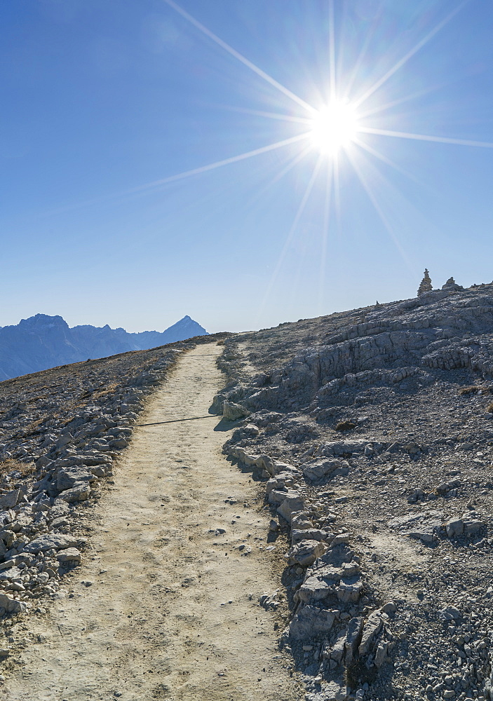 Sun over path in the Dolomites, South Tyrol, Italy