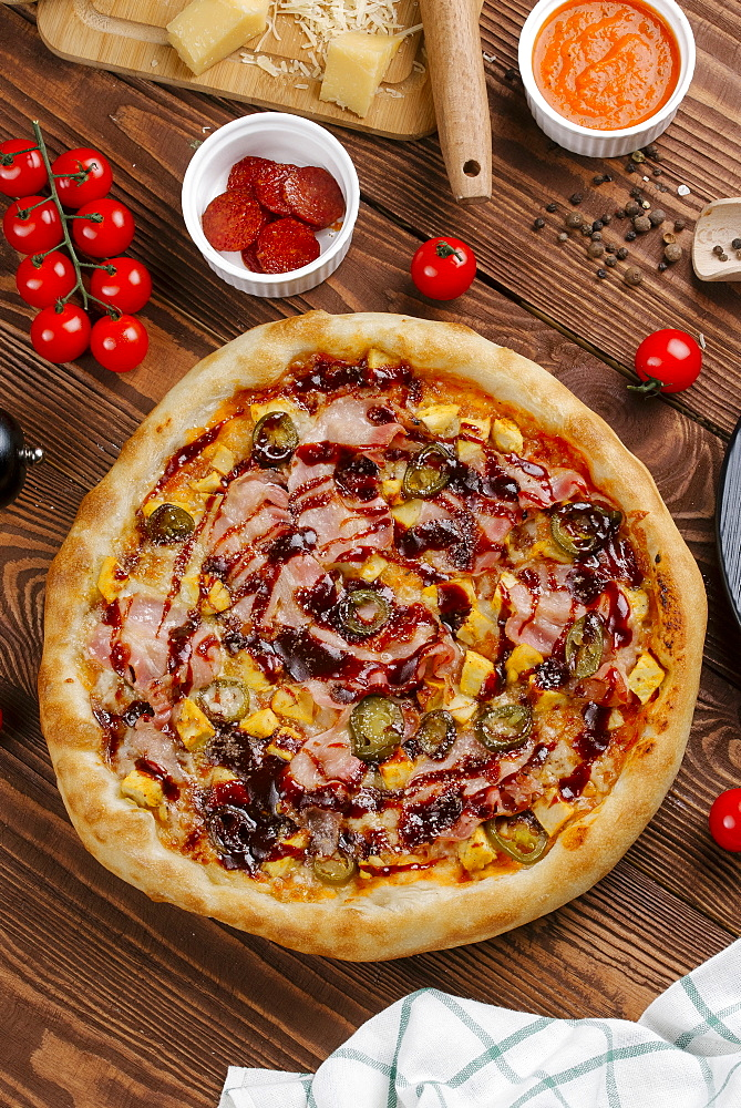 Pizza and ingredients on wooden table - 1178-26617