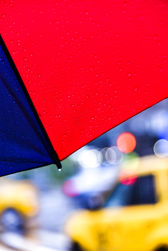 Close up of umbrella on rainy day