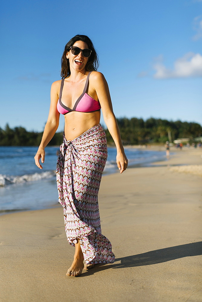 Woman in sarong at beach