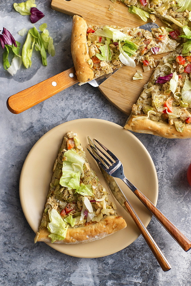 Pizza topped with cabbage
