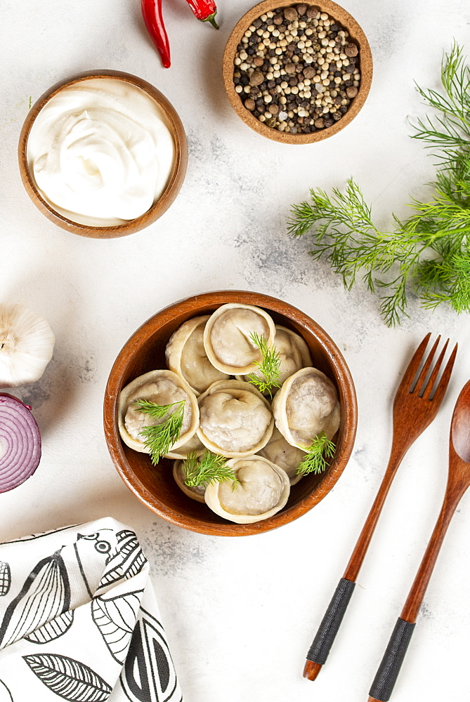 Dumplings in bowl with dill