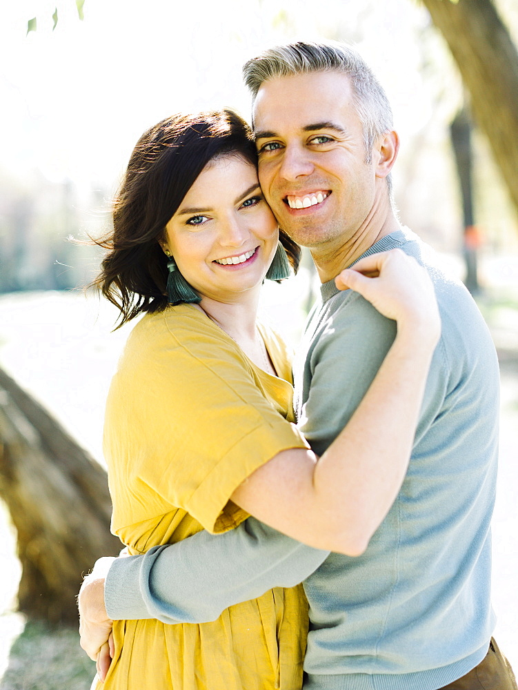 Smiling mid adult couple embracing in park
