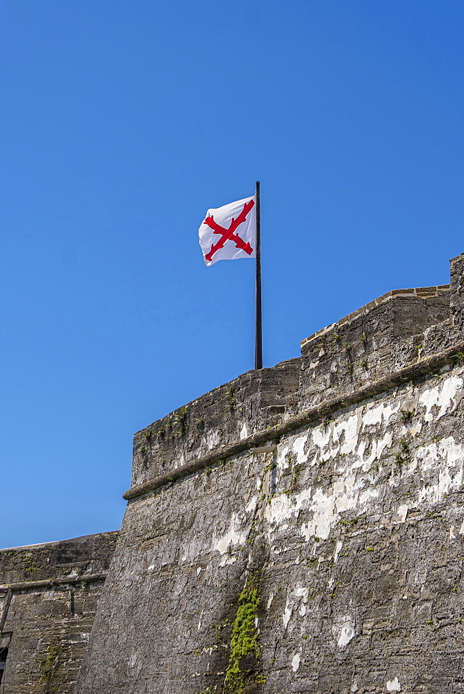 Cross of Burgundy flag on Castillo de San Marcos in St. Augustine, USA