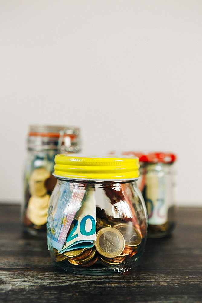 Euro currency in glass jars