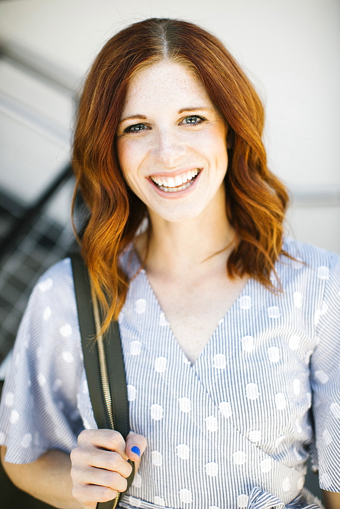 Smiling mid adult woman with red hair