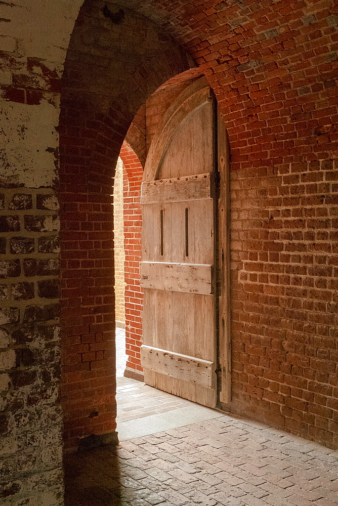 Open door and brick wall