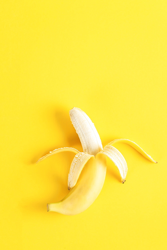 Banana on yellow surface