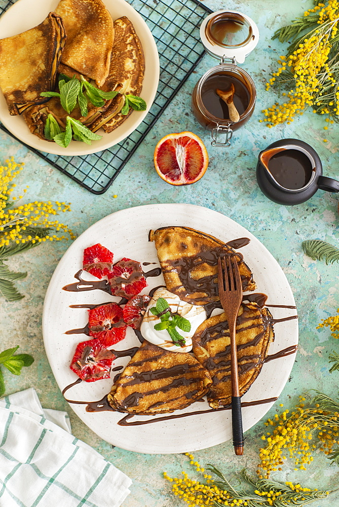 Crepes with chocolate sauce and blood oranges