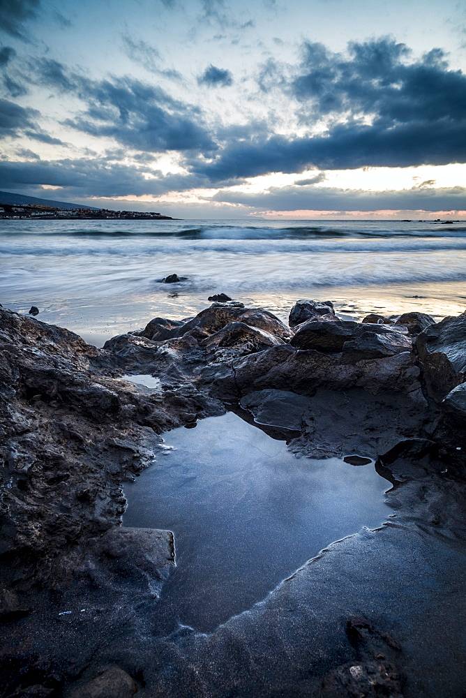 Rocks on beach at sunset in Tenerife, Spain