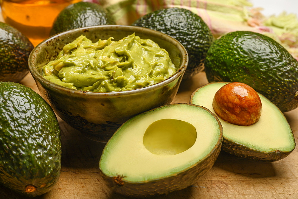 Bowl of guacamole with avocados