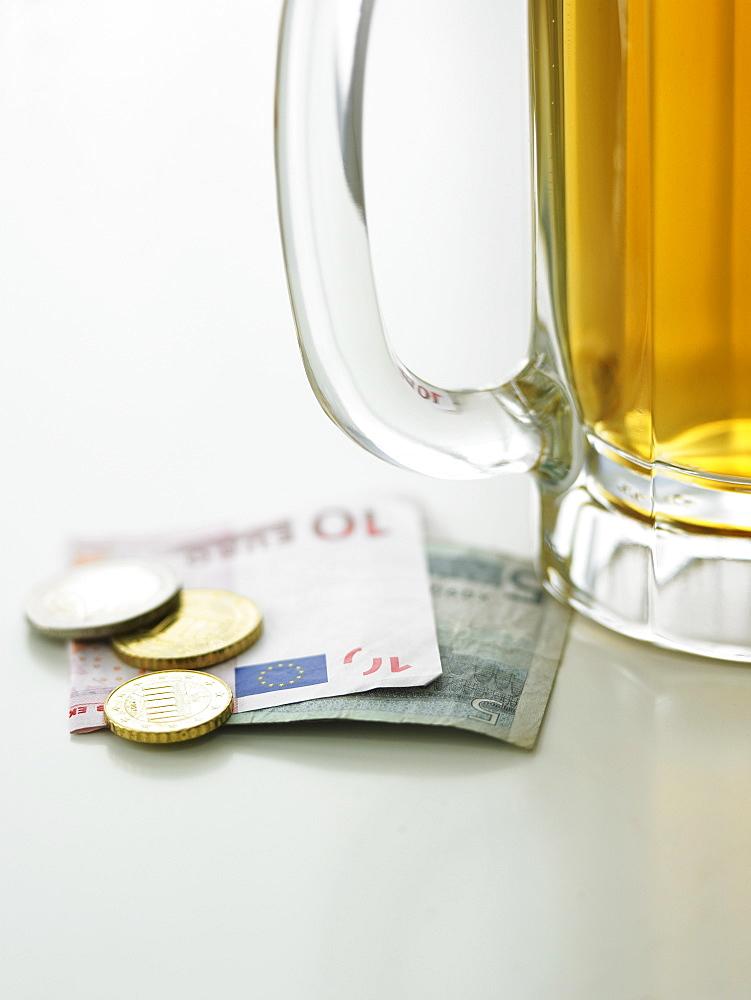 Beer mug and currency