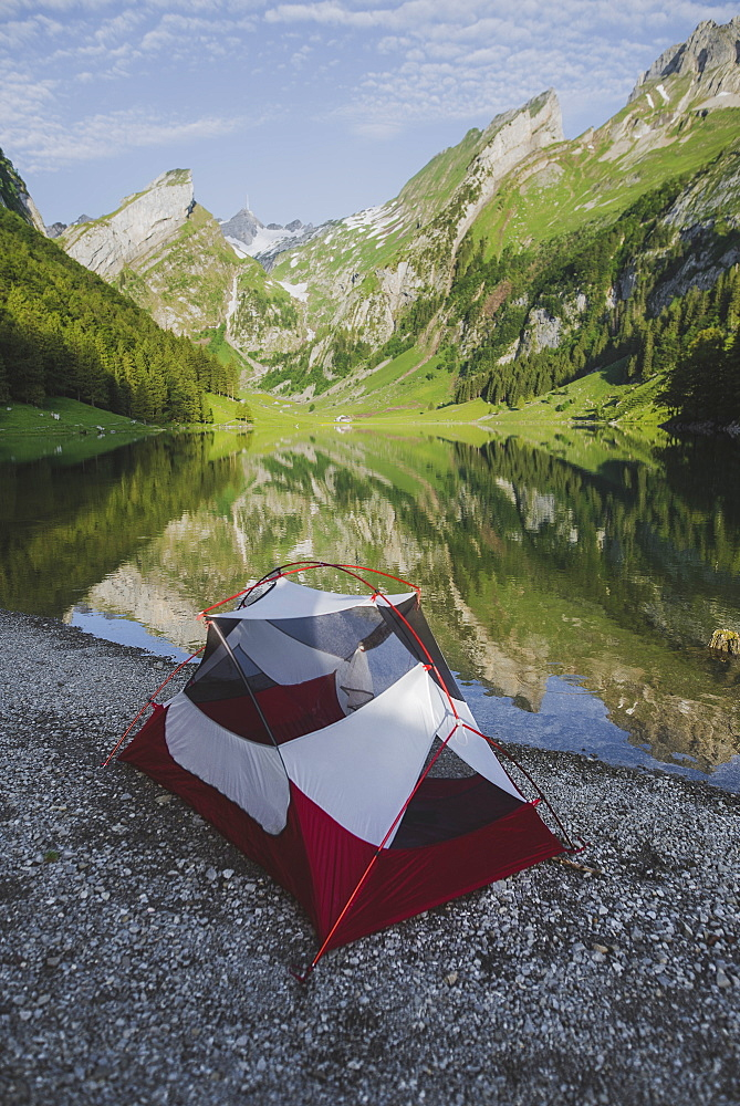 Tent by Seealpsee lake in Appenzell Alps, Switzerland