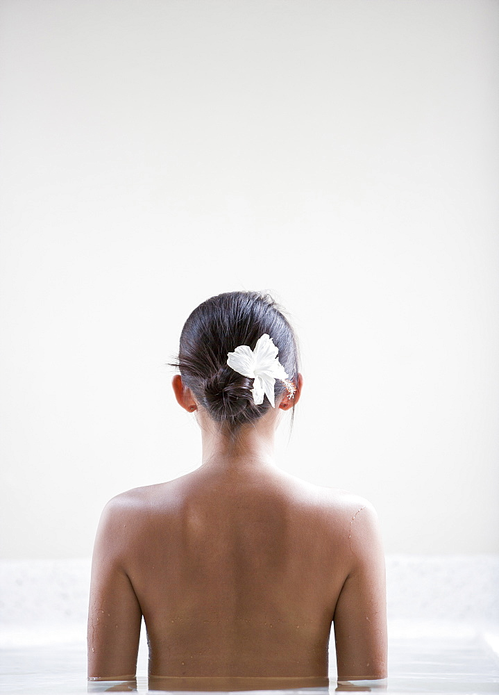 Rear view of woman in spa