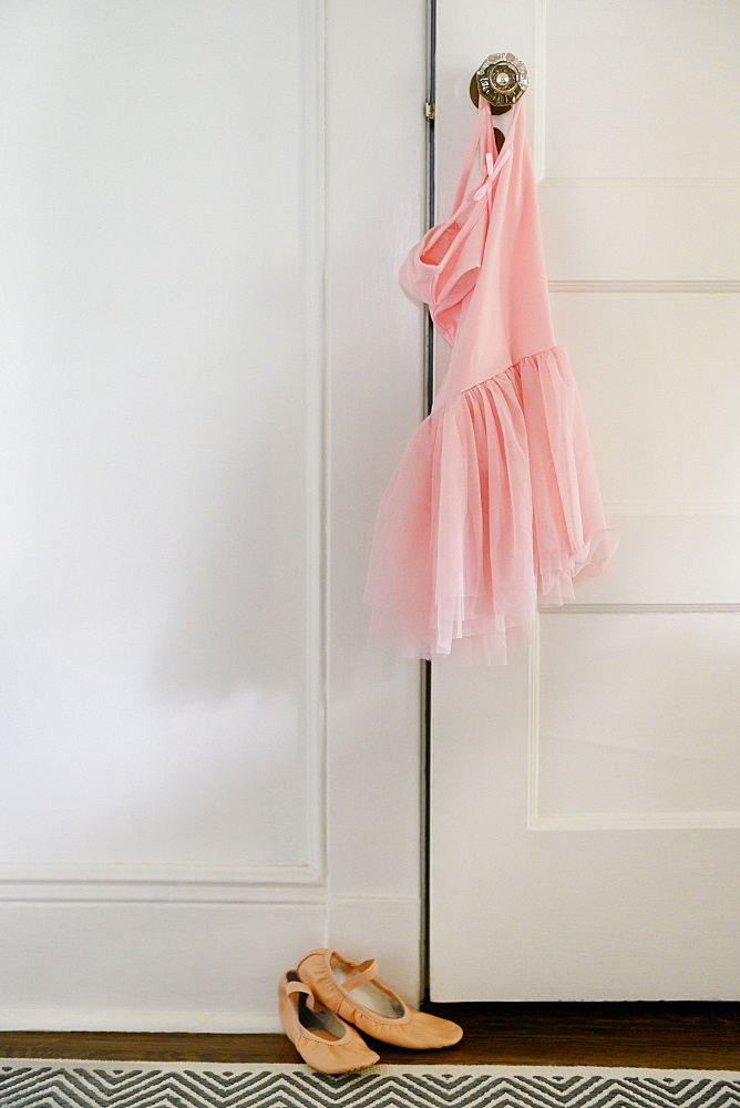 Pink ballet tutu hanging on doorknob