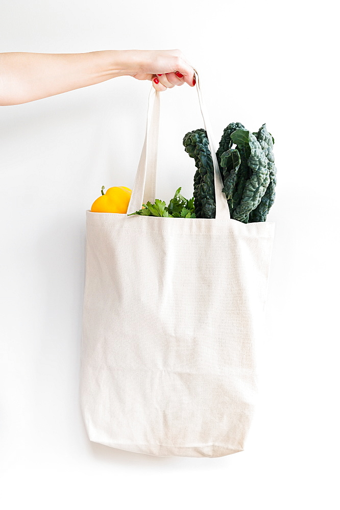 Woman holding bag of vegetables