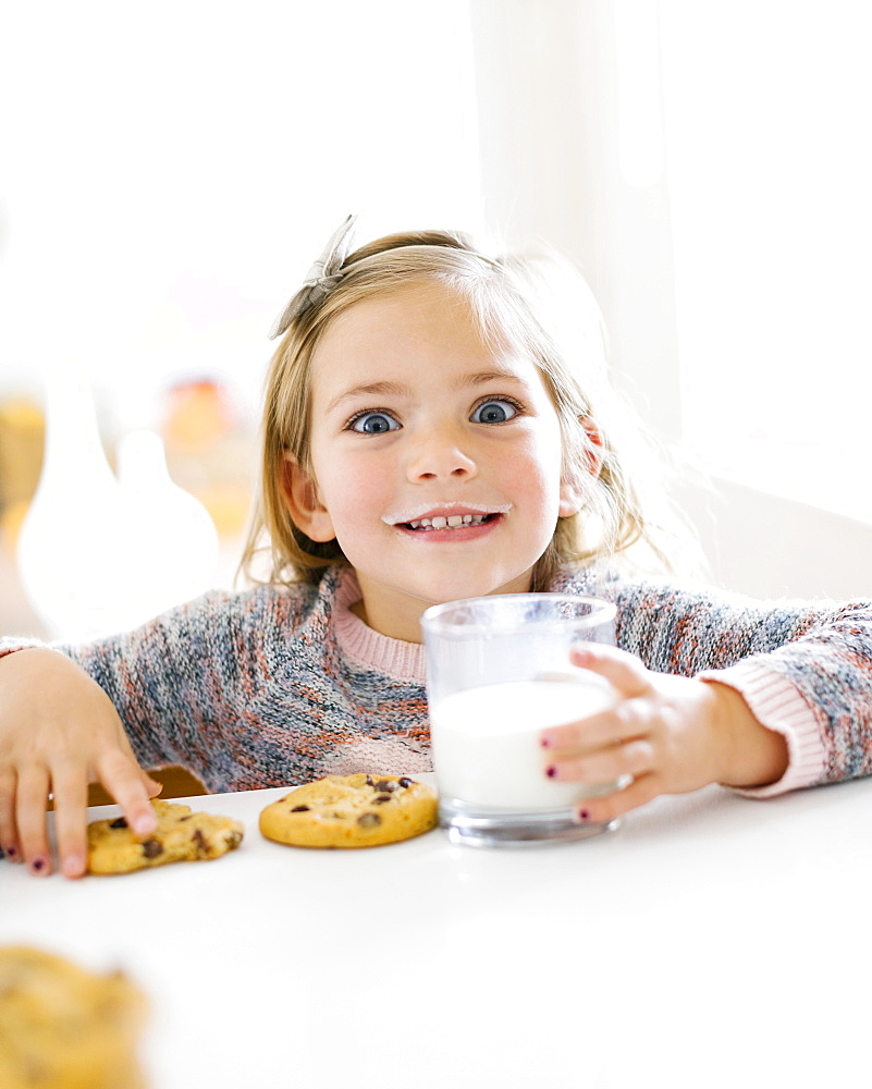 Girl eating milk and cookies - 1178-28617
