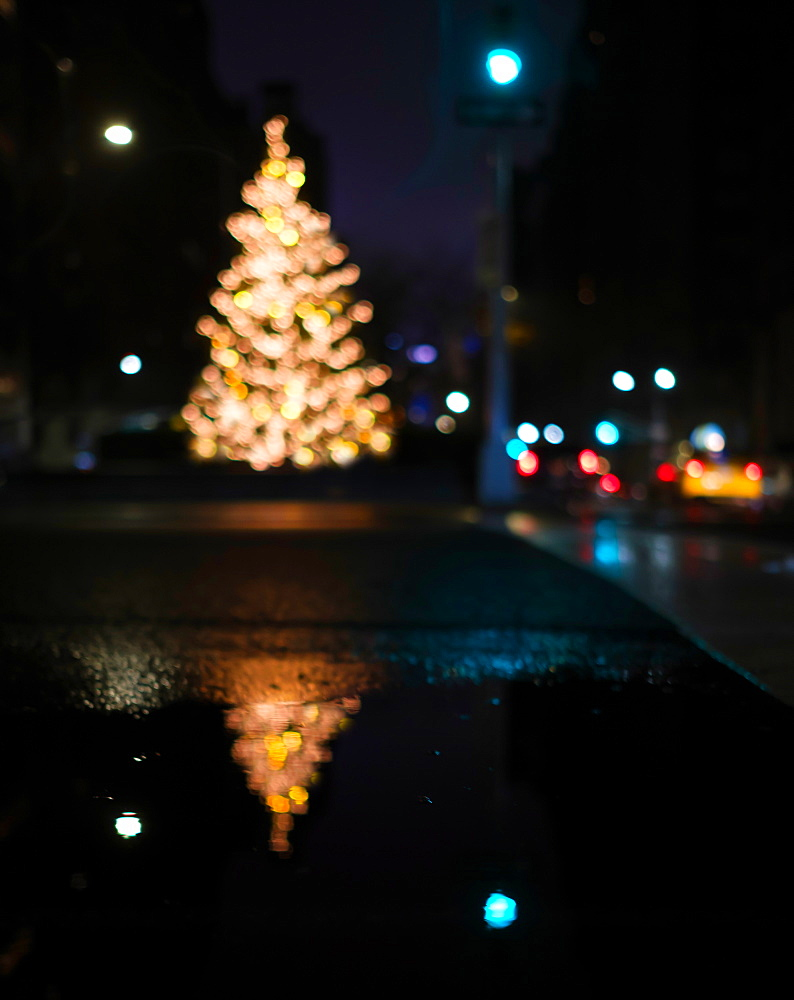 Defocussed Christmas tree illuminated at night