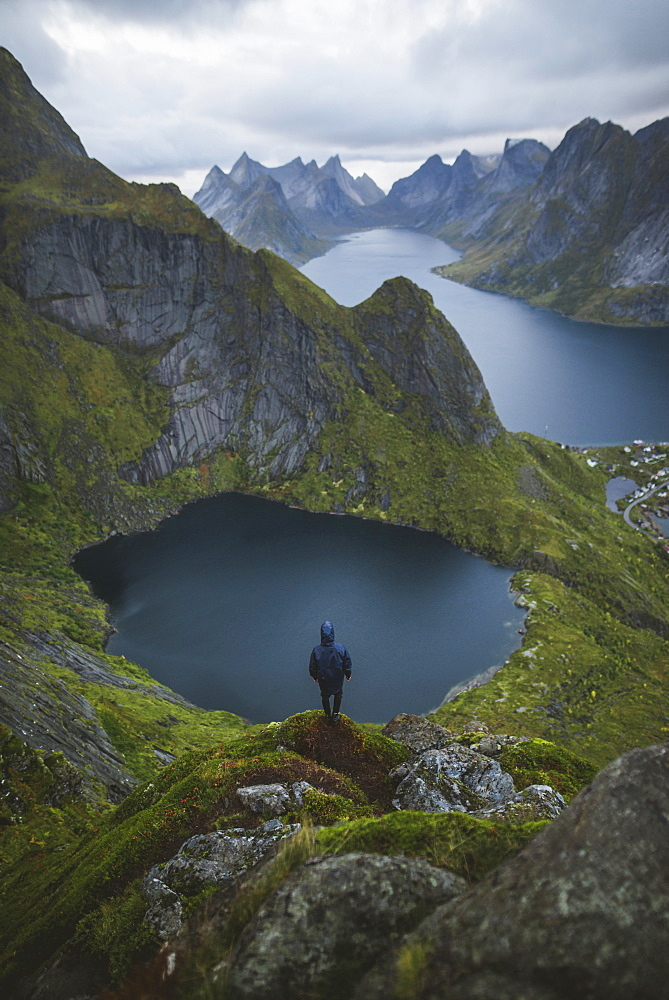 Norway, Lofoten Islands, Reine, Man looking at view from Reinebringen mountain
