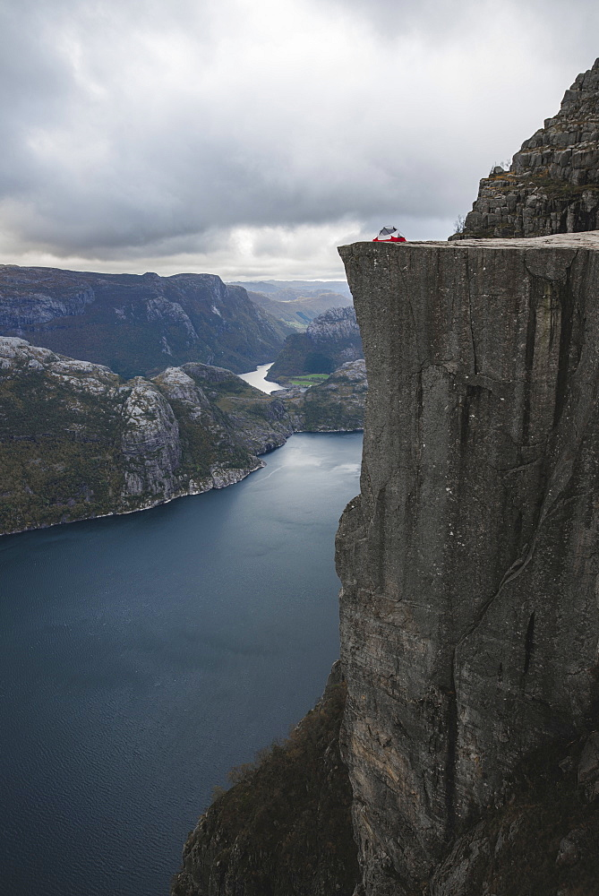 Tent in distance on Preikestolen cliff in Rogaland, Norway
