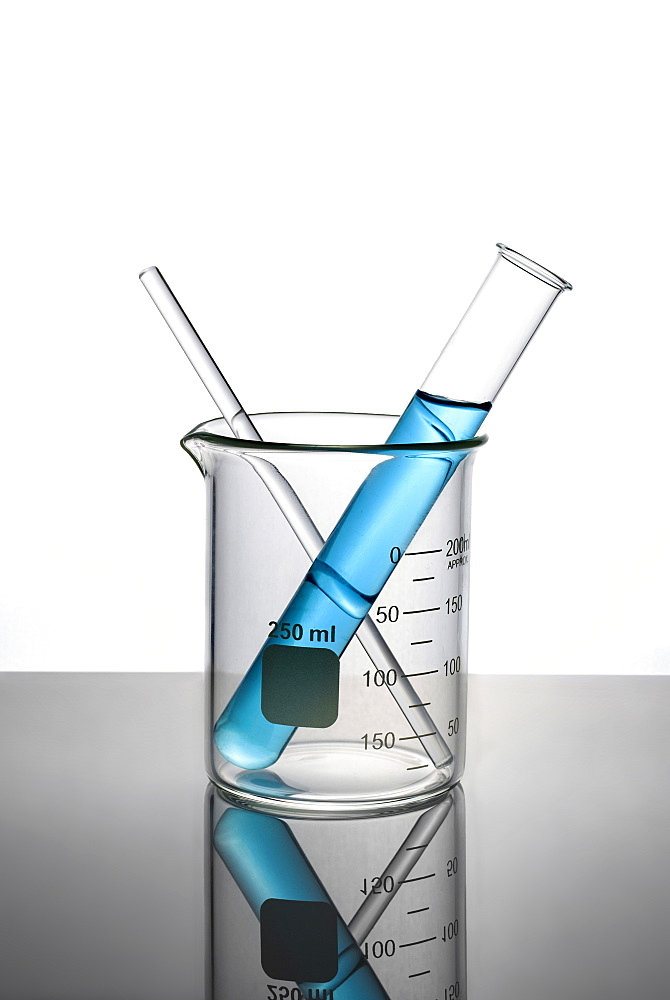 Blue liquid in test tube inside beaker