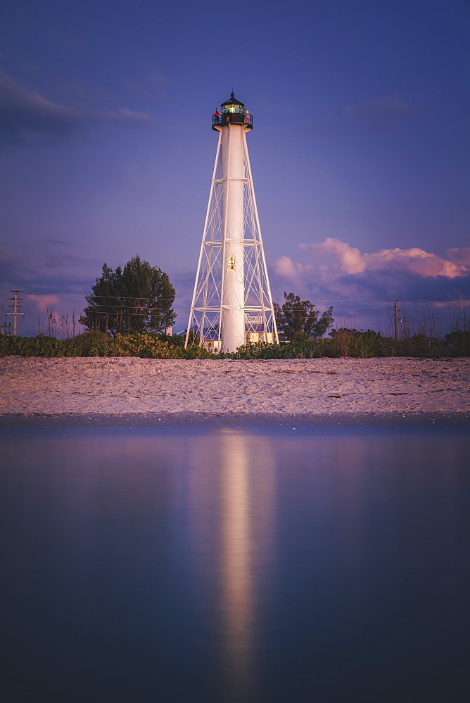 USA, Florida, Boca GrandeLighthouse reflecting in sea at night