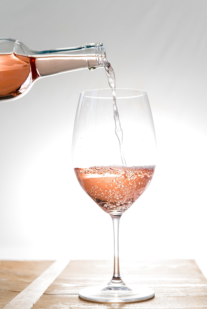Rose wine being poured into glass