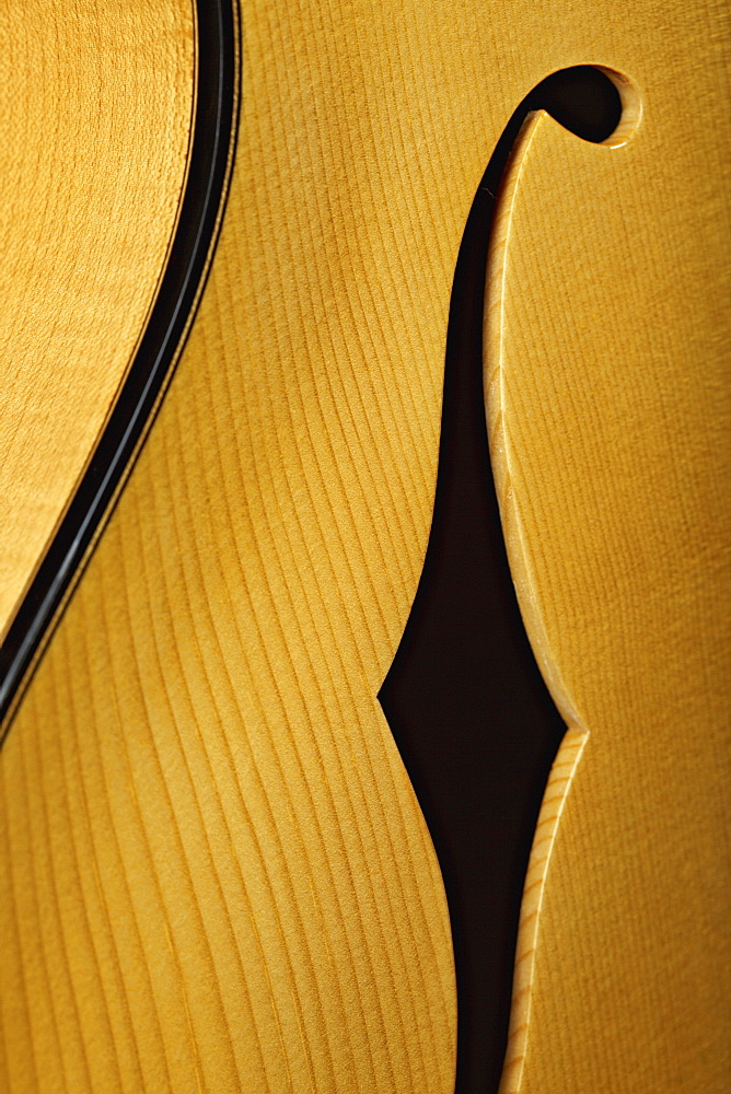 Close up of acoustic guitar body